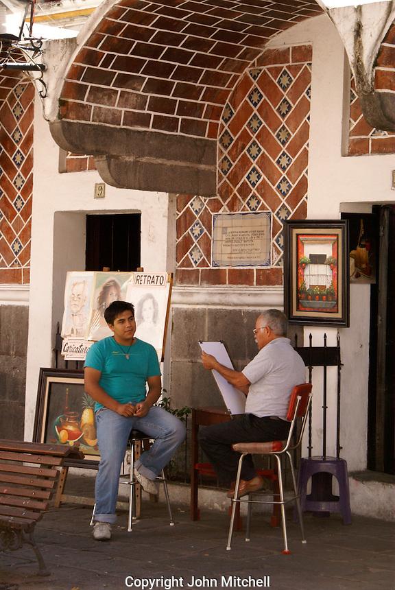 Artist drawing a young man's portrait, Barrio del Artista  in the city of Puebla, Mexico