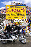 Suzanne Lee and Sanjit Das have their picture taken for the 4 time at the World's Highest Motorable Road, Khardung La, while filming with the Sony ActionCam POV cameras during their motorcycle ride Across the Indian Himalayas on Royal Enfield motorcycles.