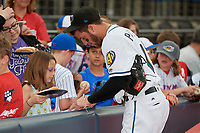 Akron RubberDucks Alexis Pantoja (1) signs autographs for young fans before an Eastern League game against the Reading Fightin Phils on June 4, 2019 at Canal Park in Akron, Ohio.  Akron defeated Reading 8-5.  (Mike Janes/Four Seam Images)