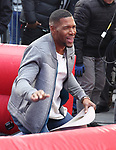 Michael Strahan riding a Mechanical Bull during a Good Morning America filming promoting PBR: Unleash the Beast in Times Square on January 4, 2019 in New York City.