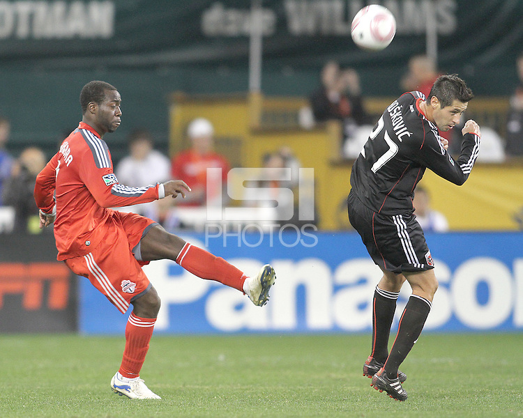 Branko Boskovic #27 of D.C. United gets in the way of a shot from Nana Attakora #3 of Toronto FC during an MLS match that was the final appearance of D.C. United's Jaime Moreno at RFK Stadium, in Washington D.C. on October 23, 2010. Toronto won 3-2.