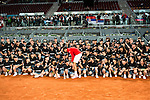 Serbian Novak Djokovic pose for the media with all the ball boys during  TPA Finals Mutua Madrid Open Tennis 2016 in Madrid, May 08, 2016. (ALTERPHOTOS/BorjaB.Hojas)