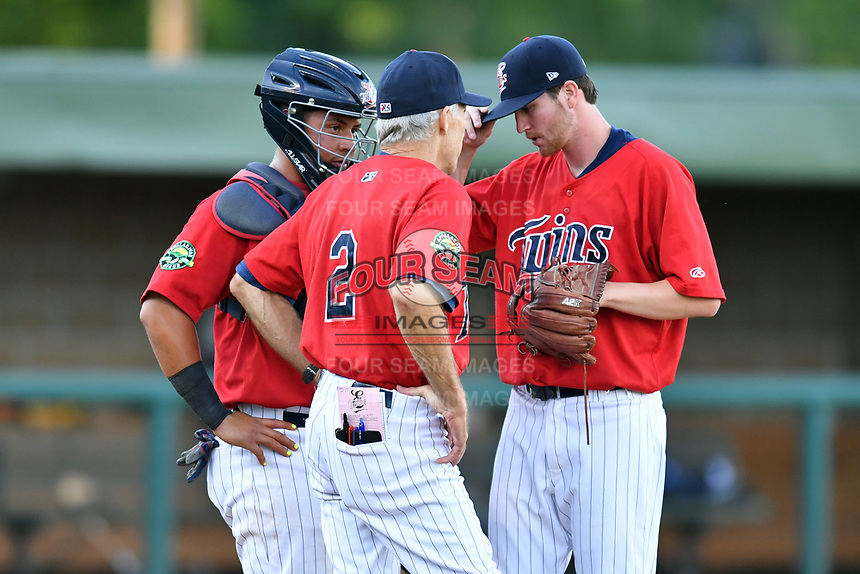 Elizabethton Twins catcher Rainis Silva (6), manager Ray Smith (2) and starting pitcher Charlie Barnes (21) have a conversation on the mound during a game against the Pulaski Yankees at Joe O'Brien Field on June 27, 2016 in Elizabethton, Tennessee. The Yankees defeated the Twins 6-4. (Tony Farlow/Four Seam Images)