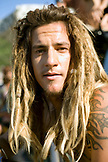 USA, Hawaii, portrait of young man with dreaklocks and tattoo at the Eddie surfing competition, the North Shore Oahu