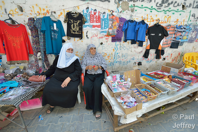 Two women selling items along a street in Shejaiya, a neighborhood of Gaza City that was hard hit by the Israeli military during the 2014 war.