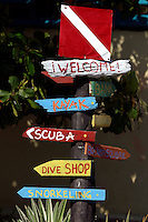 A sign guiding tourists to various activities on the main island in the Los Roques National Park.