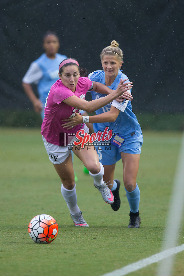 Kendall Fischlein (23) of the Wake Forest Demon Deacons fights past Katie Bowen (15) of the North Carolina Tar Heels during first half action at Spry Soccer Stadium on September 27, 2015 in Winston-Salem, North Carolina.  The Tar Heels defeated the Demon Deacons 1-0.  (Brian Westerholt/Sports On Film)