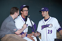 Blake Rutherford (center) is interviewed by Winston-Salem Dash color commentator Jake Eisenberg with an assist from pitcher Dylan Cease (29) prior to the game against the Lynchburg Hillcats at BB&T Ballpark on May 3, 2018 in Winston-Salem, North Carolina. The Dash defeated the Hillcats 5-3. (Brian Westerholt/Four Seam Images)