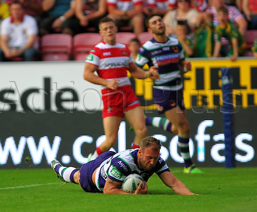 05.07.2013 Wigan, Greater Manchester, England. Michael Platt of Bradford Bulls scores a try during the Super League game between Wigan Warriors and Bradford Bulls at the DW Stadium.