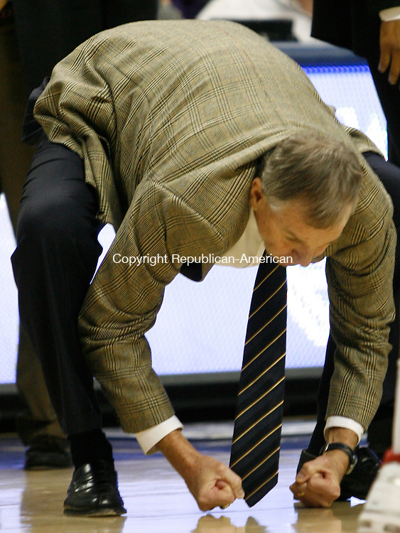 Storrs, CT-20 January 2008-012001MK13 UConn's  Head Coach Jin Calhoun clinch's his fists in frustration during the game against Marquette  Sunday afternoon at Gampel Pavilion.  Connecticut won the contest 89 - 73 over the Golden Eagles. Michael Kabelka / Republican-American ()CQ