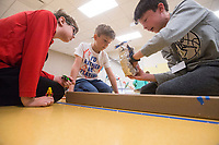 NWA Democrat-Gazette/BEN GOFF @NWABENGOFF<br /> Kingston Stone (from left), 9, of Fayetteville, Grayson Parrish, 8, of Bentonville and Henry Woods, 10, of Rogers construct a track for Hot Wheels cars from recycled materials Wednesday, March, 21, 2018, during the &quot;Wheels, Wings &amp; Motorized Things&quot; Spring Break camp at the Scott Family Amazeum in Bentonville. The camp, inspired by the museum's temporary exhibit Hot Wheels: Race to Win, gives campers hands on opportunities to explore elements of physics such as gravity, friction and momentum.