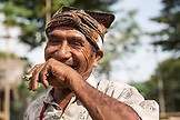 INDONESIA, Flores, an elder man Rufus Goa smokes and has a laugh in Kampung Tutubhada village in Rendu