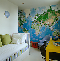 A map of the world covers the whole of one wall in this child's bedroom