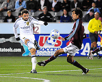 25 October 08: Real Salt Lake midfielder Dema Kovalenko kicks the ball past Rapids midfielder Mehdi Ballouchy. Real Salt Lake tied the Colorado Rapids 1-1 at Dick's Sporting Goods Park in Commerce City, Colorado. The tie advanced Real Salt Lake to the playoffs.