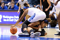DURHAM, NC - NOVEMBER 29: Azana Baines #11 of Duke University climbs over Kennedy Suttle #4 of the University of Pennsylvania while chasing a loose ball during a game between Penn and Duke at Cameron Indoor Stadium on November 29, 2019 in Durham, North Carolina.