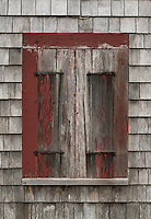 Shuttered windown of abandoned old house.