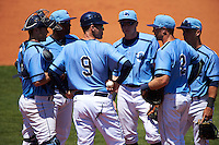 Charlotte Stone Crabs manager Michael Johns (9) makes a pitching change as (L-R) catcher Mac James, third baseman  Cristian Toribio, shortstop Alec Sole, first baseman Grant Kay (2) and second baseman Jace Conrad look on during a game against the Palm Beach Cardinals on April 10, 2016 at Charlotte Sports Park in Port Charlotte, Florida.  Palm Beach defeated Charlotte 4-1.  (Mike Janes/Four Seam Images)
