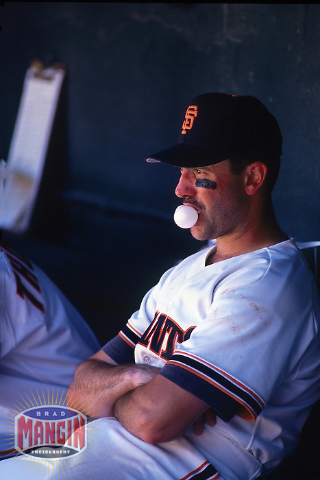 SAN FRANCISCO, CA - Will Clark of the San Francisco Giants blows a bubble in the dugout during game at Candlestick Park in San Francisco, California in 1992. Photo by Brad Mangin
