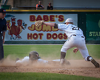 Mt. Carmel's Beau Filkens tags out Libertyville's Conner Simpson at third base in the fourth inning.