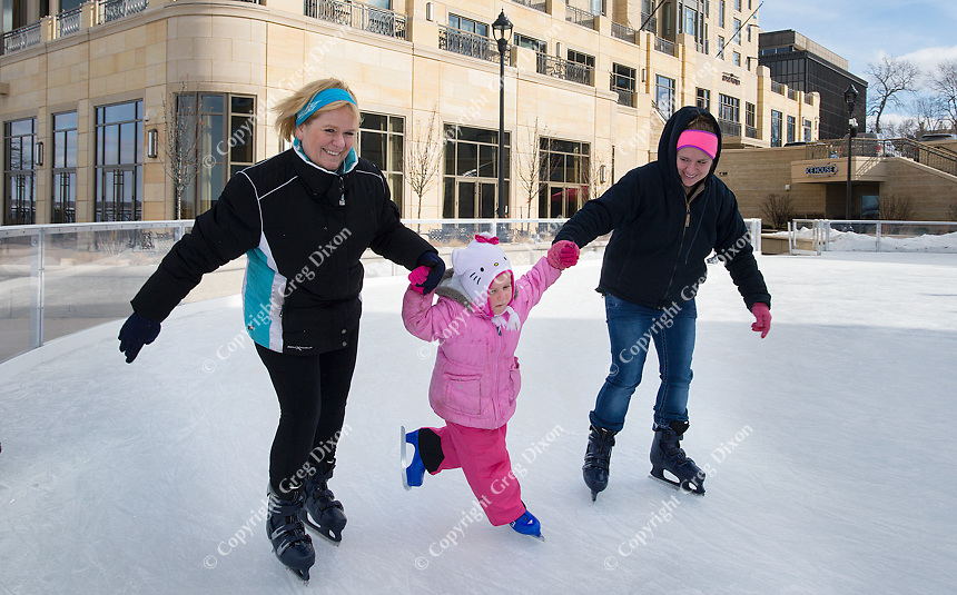 A young girl learns to ice skate for the first time at The Edgewater ice skating rink on Saturday in Madison