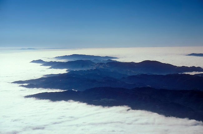 Aerial of fog over Napa Valley.  The view from over St. Helena looks south over Mayacamas range toward San Francisco Bay