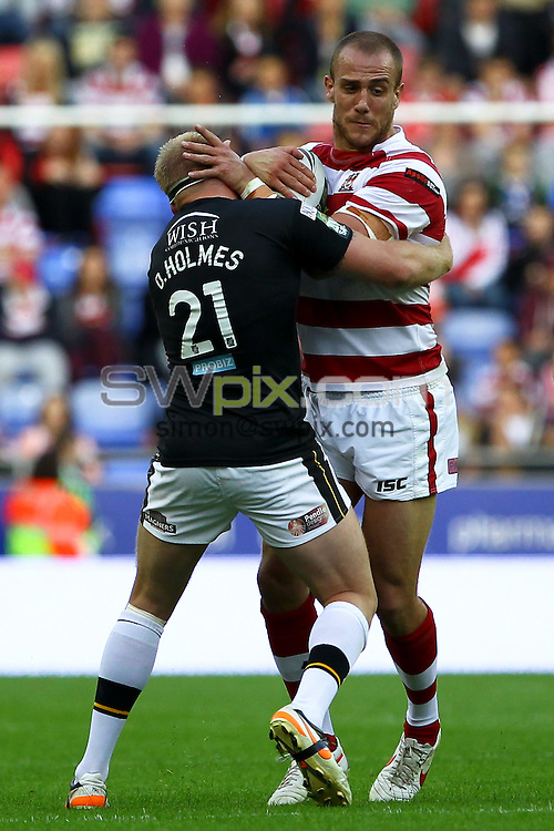 PICTURE BY ALEX WHITEHEAD/SWPIX.COM - Rugby League - Super League - Wigan Warriors v Castleford Tigers - DW Stadium, Wigan, England - 27/07/12 - Wigan's Lee Mossop is tackled by Castleford's Oliver Holmes.