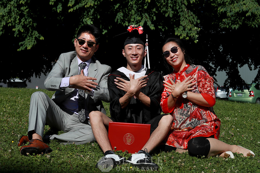 July 12th 2017 - International student, Xiangyu Kimi Kong, Social Work '17, from Dalian, China poses with his parents on campus after completing his degree at Seattle University.