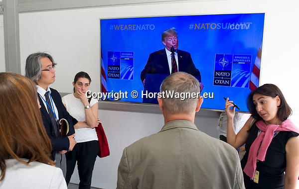 Belgium, Brussels - July 12, 2018 -- NATO summit, meeting of Heads of State / Government; here, journalists in front of a video screen following / listening US President Donald Trump during his press conference -- Photo © HorstWagner.eu