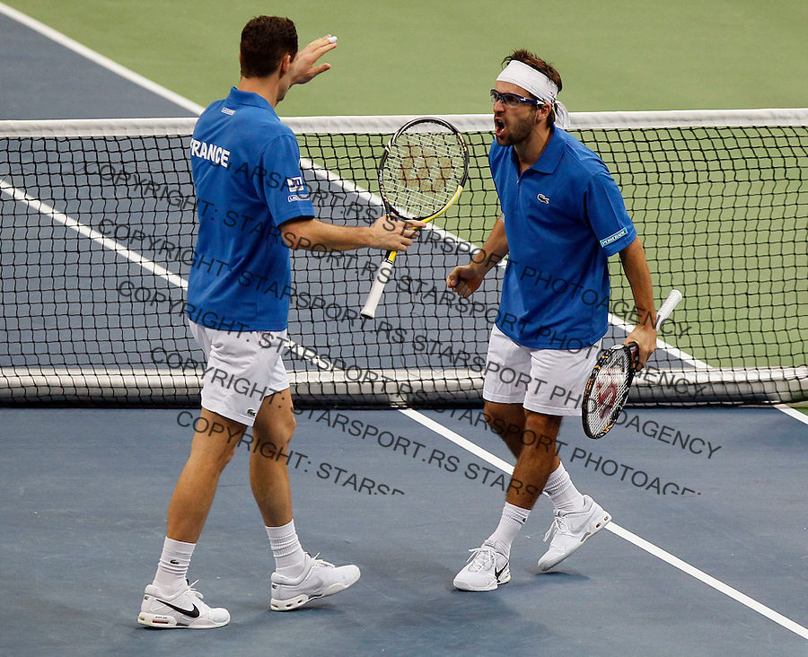 French Davis Cup players Michael Llodra, left and Arnaud Clement celebrate during their dubles match against Nenad Zimonjic and Viktor Troicki of Serbia. France leads 2:1 with only two matches remaining on Sunday. Davis Cup finals, Serbia vs France in Belgrade Arena in Belgrade, Serbia, Saturday, 4. December 2010. (credit & photo: Srdjan Stevanovic/Starsportphoto.com©)