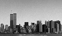 The twin towers of the World Trade Center dominate the New York City skyline in the pre-9-11 days of summer 1999.  Photographed on T-Max 3200 Black and White film.  (Photo by Brian Cleary/www.bcpix.com)