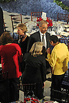 Attorney General nominee Eric Holder stands with a group of women at the luncheon following Barack Obama's swearing in as the 44th President of the United States at Statuary Hall in the U.S. Capitol in Washington, DC on January 20, 2009.