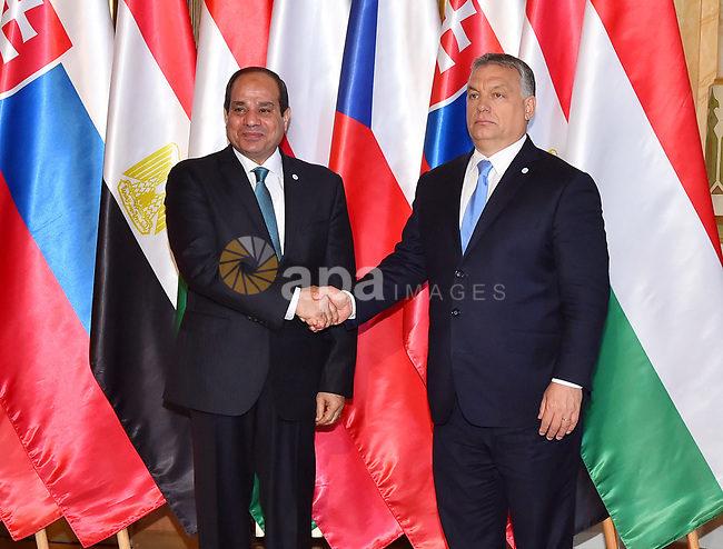 Egyptian President Abdel Fattah al-Sisi shakes hands with Hungarian Prime Minister Viktor Orban during a summit of the Visegrad group countries (V4) and Egypt in Budapest on July 4, 2017. Photo by Egyptian President Office