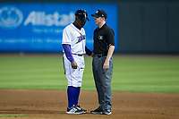 Winston-Salem Dash manager Willie Harris (1) discusses a call with first base umpire Austin Jones during the game against the Buies Creek Astros at BB&T Ballpark on April 13, 2017 in Winston-Salem, North Carolina.  The Dash defeated the Astros 7-1.  (Brian Westerholt/Four Seam Images)