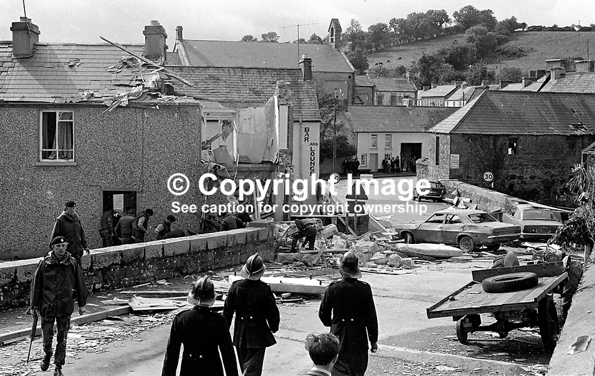 British soldiers and local firemen at the scene of a Provisonal IRA explosion in Tullyhommon, Co Fermanagh, N Ireland. The target was the local post office which straddled the N Ireland border with the Rep of Ireland. The buildings on the other side of the bridge are in Pettigo, Co Donegal, Rep of Ireland. A bomb disposal officer Ron Beckett died trying to disarm the device. 197308300576. ..Copyright Image from Victor Patterson, 54 Dorchester Park, Belfast, UK, BT9 6RJ..Tel: +44 28 9066 1296.Mob: +44 7802 353836.Voicemail +44 20 8816 7153.Skype: victorpattersonbelfast.Email: victorpatterson@me.com.Email: victorpatterson@ireland.com (back-up)..IMPORTANT: If you wish to use this image or any other of my images please go to www.victorpatterson.com and click on the Terms & Conditions. Then contact me by email or phone with the reference number(s) of the image(s) concerned.