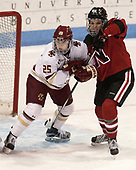 Caroline Ross (BC - 25), Ainsley MacMillan (NU - 66) - The Boston College Eagles defeated the Northeastern University Huskies 2-1 to win the Beanpot on Monday, February 7, 2017, at Matthews Arena in Boston, Massachusetts.