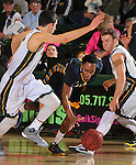 SPEARFISH, SD - FEBRUARY 6, 2016 -- Joshua Blaylock #1 of Ft. Lewis College dribbles between Black Hills State defenders Nick Ongarato #2 and Tate Hilgenkamp #23 during their college basketball game Saturday at the Donald E. Young Center in Spearfish, S.D.  (Photo by Dick Carlson/Inertia)