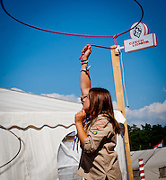 A girl is doing the lariat in front of the Czech Foodhouse for their reception. Photo: André Jörg/ Scouterna
