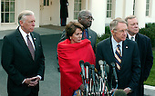"""Washington, D.C. - January 10, 2007 -- Democratic Congressional Leadership makes remarks at the White House following their meeting with United States President George W. Bush.  From left to right: United States Representative Steny H. Hoyer (Democrat of Maryland) House Majority Leader; Speaker of the House Nancy Pelosi (Democrat of California); U.S. Representative Jim Clyburn (Democrat of South Carolina), House Majority Whip; U.S. Senator Dick Durbin (Democrat of Illinois), Senate Majority Whip; and U.S. Senator Harry Reid (Democrat of Nevada), Senate Majority Leader.  They complained that their meeting with the President was """"a notification, not a consultation""""..Credit: Ron Sachs / CNP"""