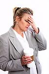 A business woman with a headache and a coffee mug