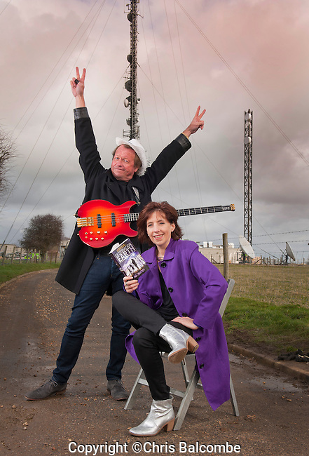 Author Ali Sparkes, pictured at the launch of her new book 'Destination Earth'.<br /> <br /> Ali is with 'Level 42' frontman Mark King, who features in the book,  infront of the giant Rowridge Transmitter on the Isle of Wight.<br /> <br /> Pic: Chris Balcombe<br /> <br /> 07568 098176