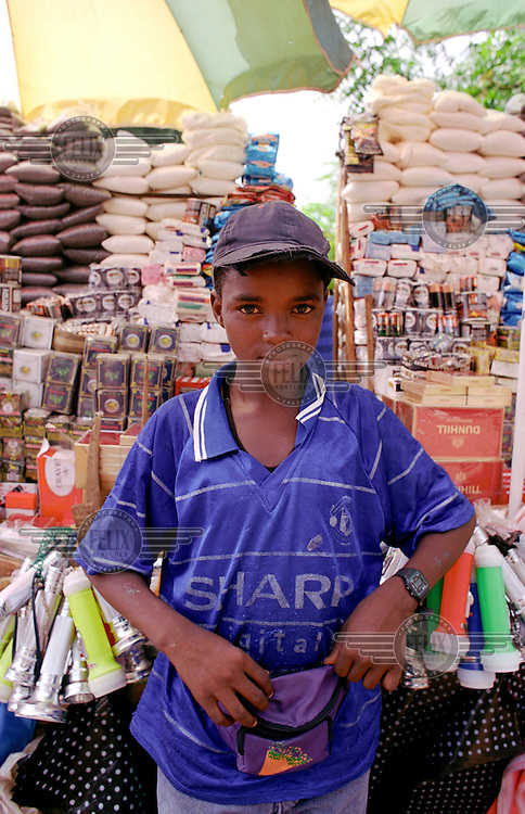 ©Crispin Hughes/Panos Pictures..MALI Bamako 2003..Boy running kiosk shop at station.