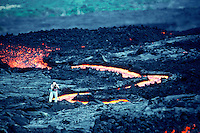Photographer shooting lava at Kilauea Volcano, Hawaii Volcanoes national park, Big Island of Hawaii