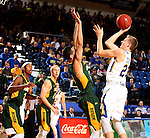 BROOKINGS, SD - DECEMBER 28:  Reed Tellinghuisen #23 from South Dakota State takes the ball to the basket against Khy Kabellis #13 from North Dakota State during their game Wednesday night at Frost Arena in Brookings. (Dave Eggen/Inertia)
