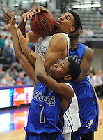 NWA Democrat-Gazette/ANDY SHUPE<br /> Fayetteville forward Brennon Lewis (top) collides with  Rogers guard R.J. Roberson Friday, Feb. 10, 2017, during the first half of play in Bulldog Arena. Visit nwadg.com/photos to see more photographs from the game.