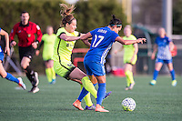 Allston, MA - Sunday, April 24, 2016: Seattle Reign FC defender Rachel Corsie (4) and Boston Breakers midfielder Kyah Simon (17). The Boston Breakers play Seattle Reign during a regular season NSWL match at Harvard University.