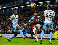Burnley's Dwight McNeil crosses under pressure from West Ham United's Michail Antonio and Grady Diangana<br /> <br /> Photographer Alex Dodd/CameraSport<br /> <br /> The Premier League - Burnley v West Ham United - Sunday 30th December 2018 - Turf Moor - Burnley<br /> <br /> World Copyright © 2018 CameraSport. All rights reserved. 43 Linden Ave. Countesthorpe. Leicester. England. LE8 5PG - Tel: +44 (0) 116 277 4147 - admin@camerasport.com - www.camerasport.com