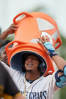 Charlotte Stone Crabs Moises Gomez (left) puts the Gatorade bucket over Wander Franco (1) head after a walk-off win during a Florida State League game against the Bradenton Maruaders on August 7, 2019 at Charlotte Sports Park in Port Charlotte, Florida.  Charlotte defeated Bradenton 3-2 in the second game of a doubleheader.  (Mike Janes/Four Seam Images)