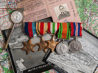 BNPS.co.uk (01202 558833)<br /> Pic: PhilYeomans/BNPS<br /> <br /> Flt lt Cooper's medals, instruments and photographs.<br /> <br /> Unearthed - fascinating unseen archive of cameras, photographs, documents and medals from a British aerial reconnaisance expert who fought all the way through Africa and southern Europe in WW2.<br /> <br /> Flt Lt Eric Cooper from London kept all his wartime paraphernalia, including his K20 handheld camera and stereoscopic plotting instruments until his death in Devon aged 96 in 2012.<br /> <br /> The incredible photographs show bombing raids, amphibious landings and badly damaged aircraft alongside off duty snaps of the campaign throughout the mediterraenean.<br /> <br /> His nephew is now selling the compelling collection at Plymouth Auction Rooms in Devon next week.