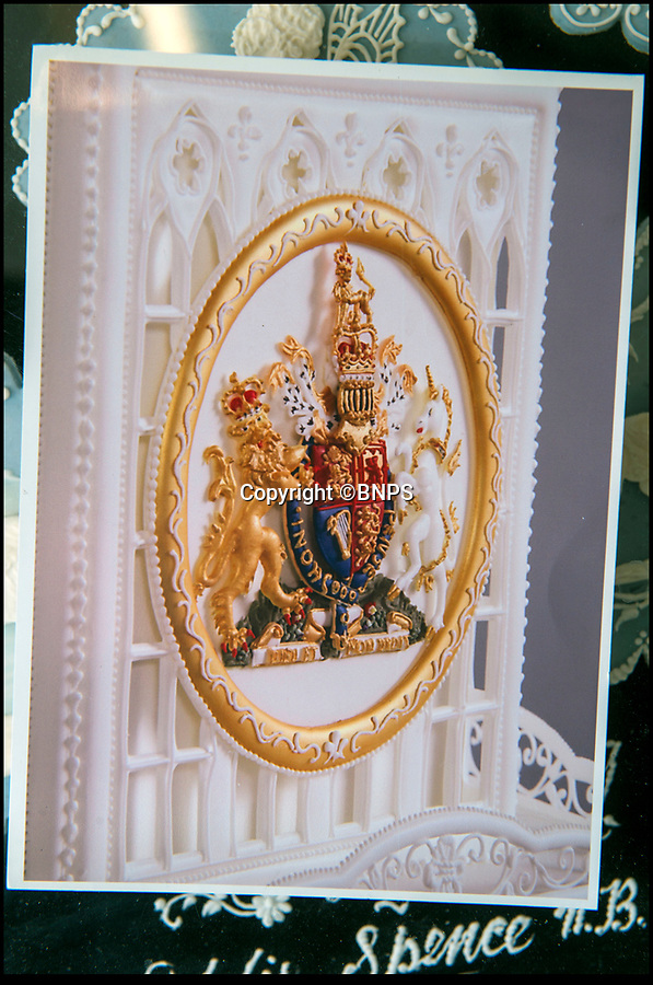 BNPS.co.uk (01202 558833)Pic: PhilYeomans/BNPS<br /> <br /> Eddie's created this elaborate crest on the cake for the Queen's Diamond Jubilee in 2013<br /> <br /> Queens cake maker finally hangs up his piping bag...<br /> <br /> Royal cake maker Eddie Spence(85) has finally had to retire after an amazing 71 year career making the spectacular cakes for many Royal occasions from weddings, anniversaries and jubilee's.<br /> <br /> Eddie Spence's renowned icing skills earned him the chance to decorate numerous cakes for major Royal occasions, including the Queen's Diamond Jubilee and Charles and Diana's wedding.<br /> <br /> He also created the cake for the Queen and Prince Philip's golden wedding anniversary - 50 years after he beat the eggs for the cake used for their wedding in 1947 as an apprentice. <br /> <br /> In 2000 Eddie was awarded an MBE in the Queen's New Year's Honours for services to sugar craft.<br /> <br /> Now aged 85, Eddie, from Bournemouth, has finally called it a day.