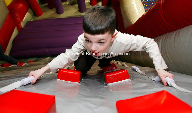 Waterbury, CT-09, February 2010-020910CM05    Nathan Wichulis, 7, of Wolcott, scales a wall  inside a bouncy house at the Jump!Zone Tuesday afternoon.  Yesterday was the opening day for the new kids entertainment center, which is located on Lakewood Road next to the Bernie's in Waterbury.  Jump!Zone features bouncy slides, obstacle courses, climbing bouncy walls and a snack bar.  Hours of operation are Tuesday through Friday from 10am-1pm and 4pm-7pm.  It's closed on Monday's and the weekends are reserved for private parties.  Anyone with questions can call 203-437-6779.    --Christopher Massa Republican-American